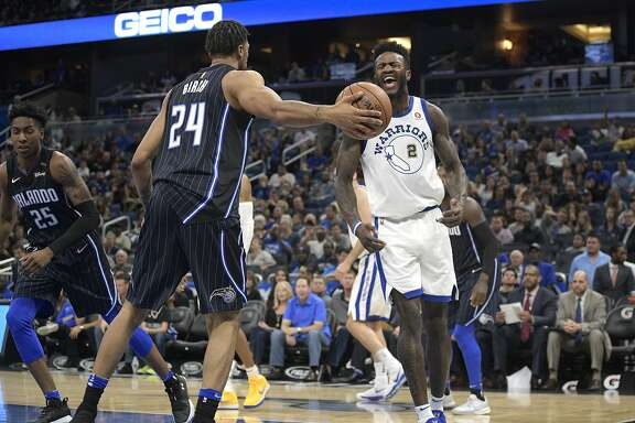 Golden State Warriors forward Jordan Bell (2) celebrates after dunking the ball in front of Orlando Magic center Khem Birch (24) during the second half of an NBA basketball game Friday, Dec. 1, 2017, in Orlando, Fla. The Warriors won 133-112. (AP Photo/Phelan M. Ebenhack)