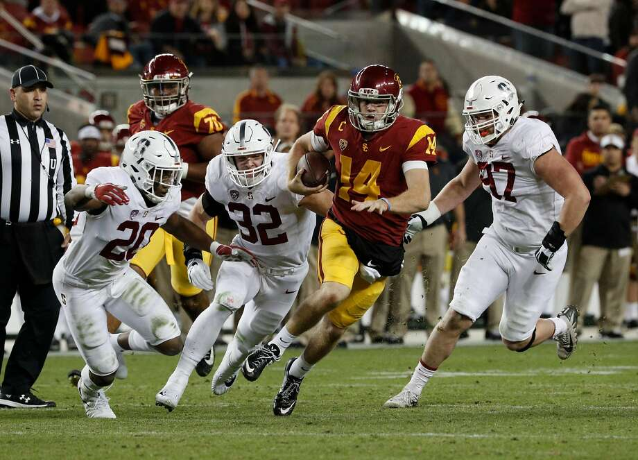 Trojan quarterback San Darnold, 14 is chased by Bobby Okereke, 20 Joey Alfieri, 32 and Dylan Jackson, 97, as the Stanford Cardinal takes on the USC Trojans in the PAC-12 championship game at Levi's Stadium, in Santa Clara Calif. on Fri. December 1, 2017. Photo: Michael Macor, The Chronicle