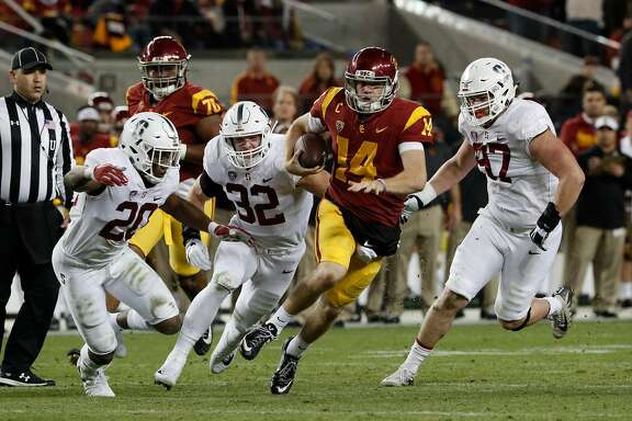 Trojan quarterback San Darnold, 14 is chased by Bobby Okereke, 20 Joey Alfieri, 32 and Dylan Jackson, 97, as the Stanford Cardinal takes on the USC Trojans in the PAC-12 championship game at Levi's Stadium, in Santa Clara Calif. on Fri. December 1, 2017.