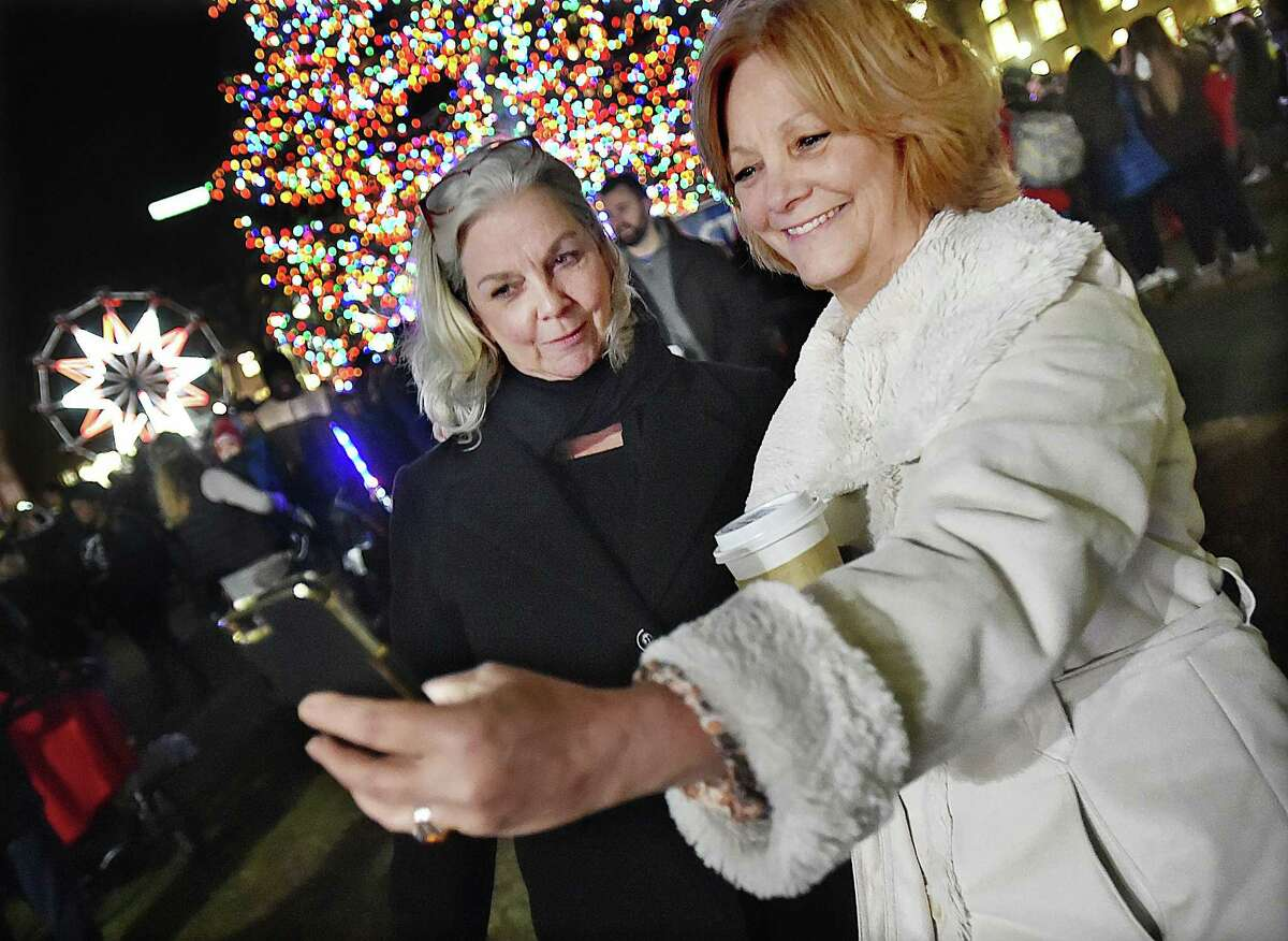 Mary McCarthy, of Wallingford takes a selfie with her sister Monica McCarthy of Prospect at the annual Christmas tree lighting on the historic New Haven Green, Thursday, Nov. 30, 2017.