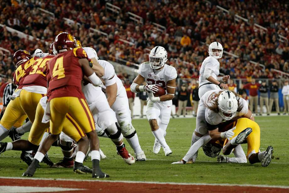Stanford's Cameron Scarlett, 22 looks for a hole but comes up short in the first half, as the Stanford Cardinal takes on the USC Trojans in the PAC-12 championship game at Levi's Stadium, in Santa Clara Calif. on Fri. December 1, 2017. Photo: Michael Macor, The Chronicle