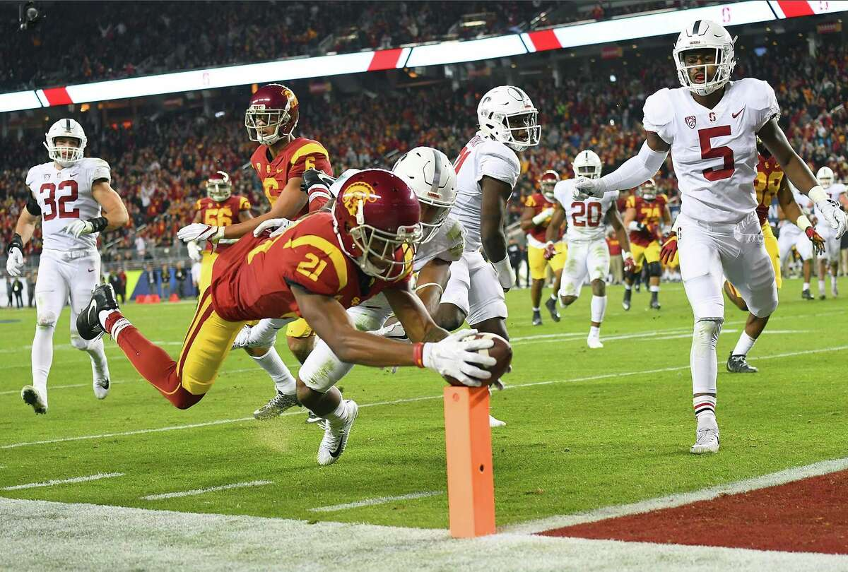 SANTA CLARA, CA - DECEMBER 01: Tyler Vaughns #21 of the USC Trojans dives into the endzone for a touchdown against the Stanford Cardinal during the Pac-12 Football Championship Game at Levi's Stadium on December 1, 2017 in Santa Clara, California. (Photo by Thearon W. Henderson/Getty Images) ORG XMIT: 775057007