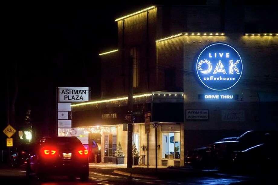 Lights illuminate Live Oak Coffeehouse on Tuesday evening. (Katy Kildee/kkildee@mdn.net)