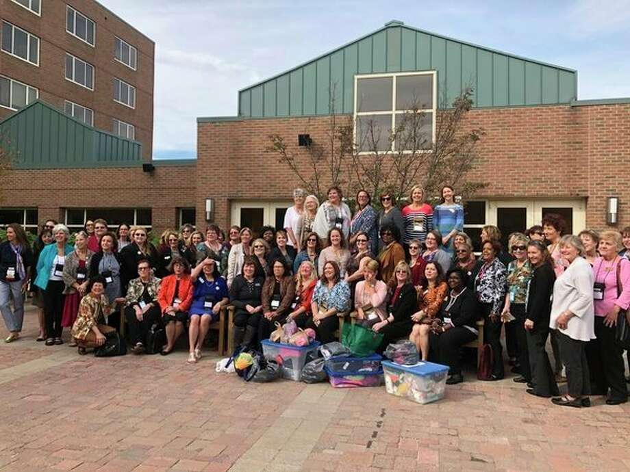 Attendees of the Zonta International District 15 Fall Conference in Midland display supplies collected for Shelterhouse. (Photo provided)