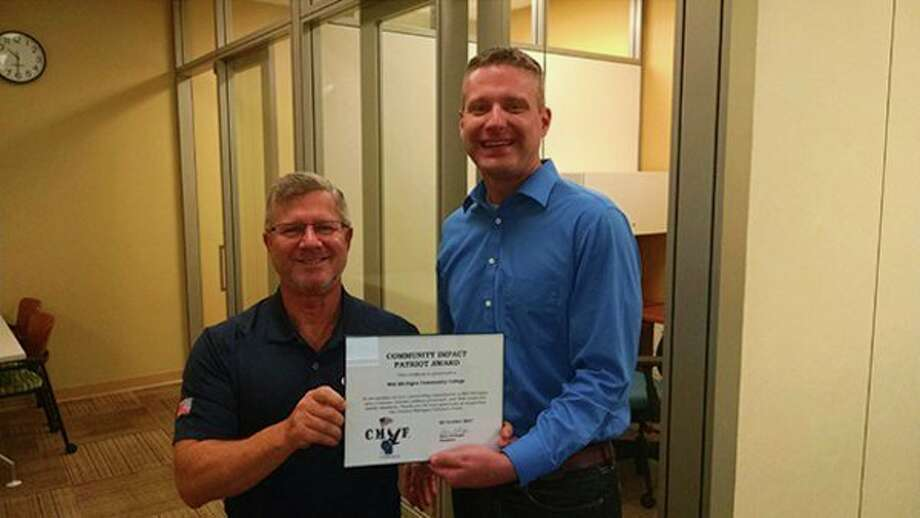 Steve Rellinger of the Central Michigan Veterans Fund stands with and Shawn Troy, dean of occupational studies at Mid Michigan Community College. (Photo provided)