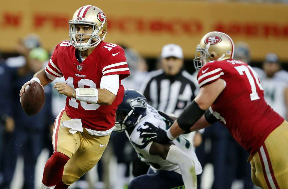 FILE - In this Sunday, Nov. 26, 2017, file photo, San Francisco 49ers quarterback Jimmy Garoppolo rolls out against the Seattle Seahawks during the second half of an NFL football game in Santa Clara, Calif. Garoppolo makes his first start for San Francisco when the 49ers visit the Chicago Bears on Sunday. (AP Photo/John Hefti, File) Photo: John Hefti, Associated Press