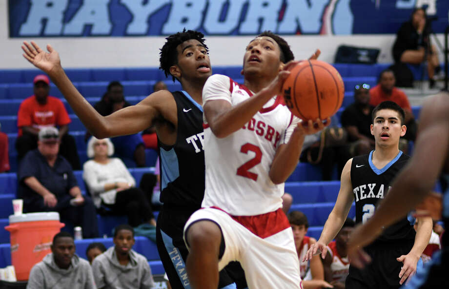 Crosby senior guard Shemar Johnson (2) drives to the hoop against a Sam Rayburn defender during their pool play matchup at the Sam Rayburn tournament at SRHS on Dec. 1, 2017. (Photo by Jerry Baker/Freelance) Photo: Jerry Baker, Freelance / Freelance