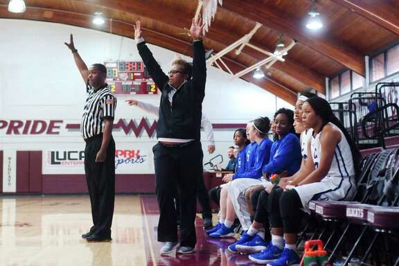 Clear Springs girls basketball coach Pam Crawford gives instructions from the sideline against Ridge Point during the Peggy Whitley Classic basketball tournament  at Clear Creek High School.