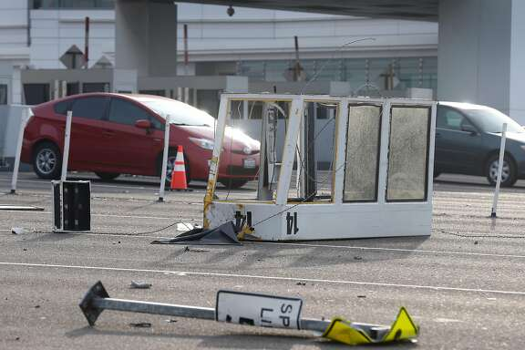 Toll booth 14 rests in westbound lanes of traffic at the Bay Bridge toll plaza after a truck rammed the booth, killing the toll collector inside, before dawn in Oakland, Calif. on Saturday, Dec. 2, 2017. The two occupants of the truck were reportedly ejected from the vehicle.