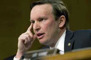 Sen. Chris Murphy, D-Conn., shown during a committee hearing earlier this year, said the tax bill would drive up costs for middle-income earners.