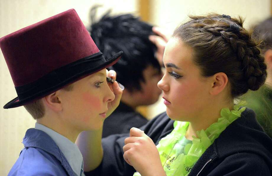 Ava S. Mastrone, at right, who portrays Glinda the Good Witch of the North applies make up to Aidan Tuite as they prepare for a dress rehearsal for the Stamford All-School Musical production of the Wizard of Oz on Thursday, Nov. 30, 2017 in Stamford, Connecticut. Photo: Matthew Brown / Hearst Connecticut Media / Stamford Advocate