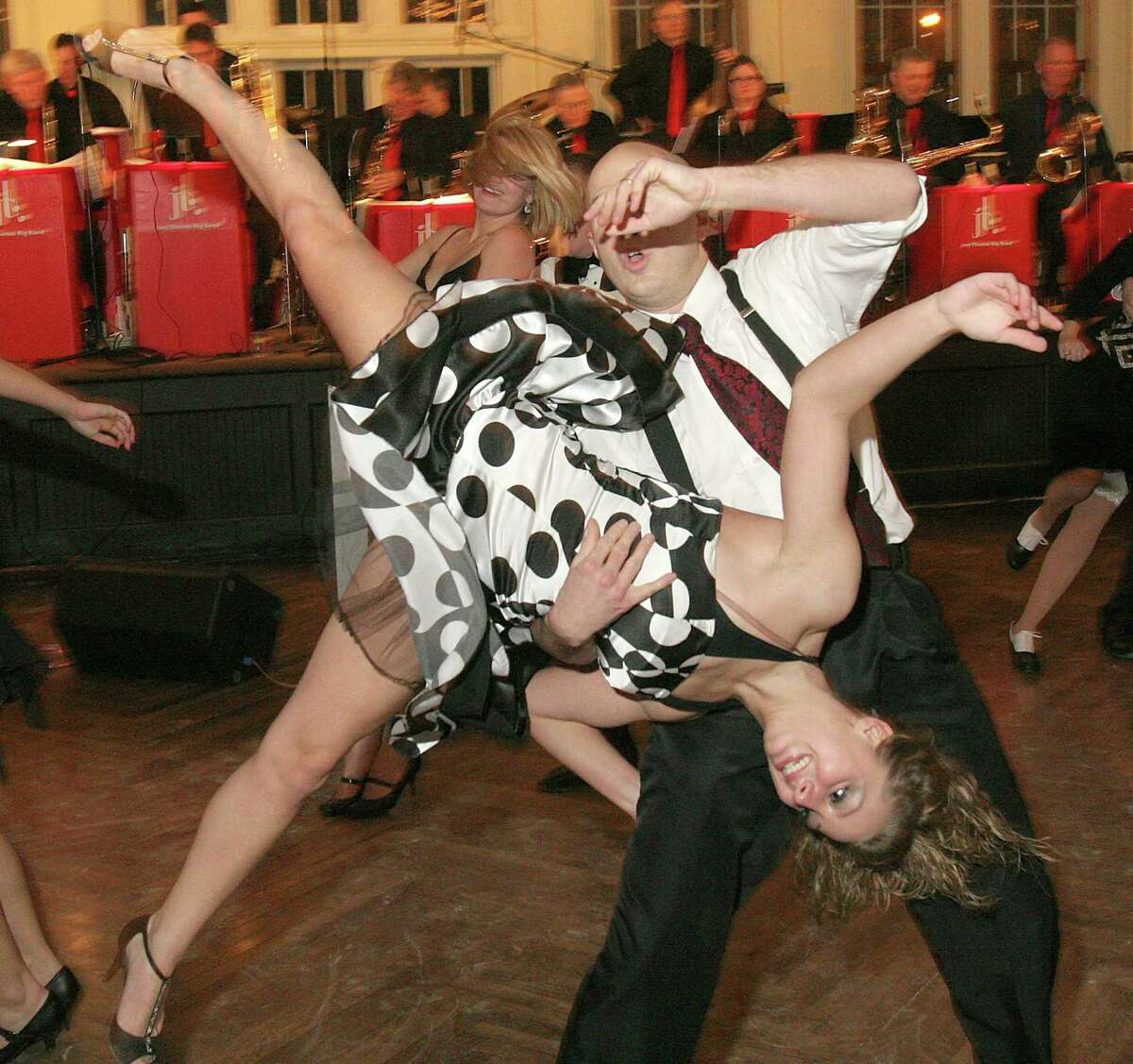 Saratoga Springs, NY - December 12, 2008 - (Photo by Joe Putrock/Special to the Times Union) - Aaron Romano(back) sends Brittany Bush(front) for a whirl on the dance floor at Dancing with the Capital Region Stars Annual Holiday Gala to benefit the Saratoga Springs History Museum.