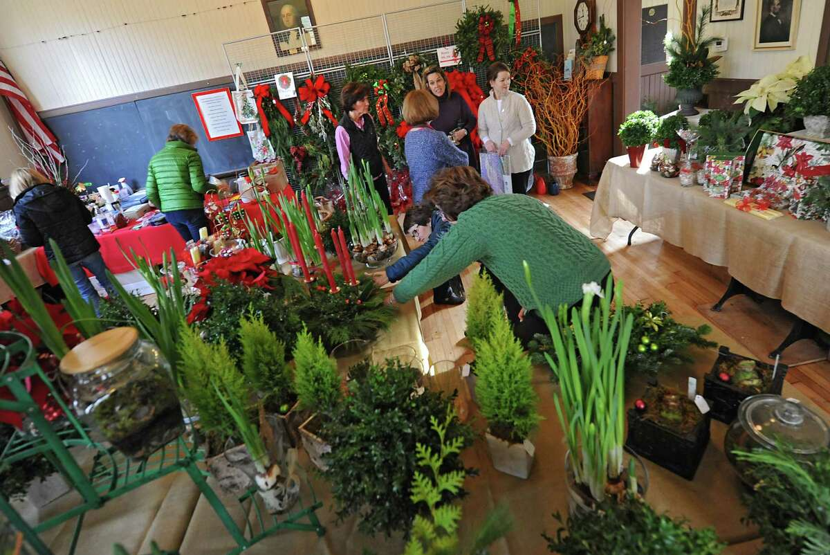 Members of the Fort Orange Garden Club set up for their Holiday Greens Sale Thursday, Dec. 4, 2014, as they set up for their Holiday Greens Sale which takes place this Friday and Saturday at the Pruyn House Schoolhouse in Colonie, N.Y. (Lori Van Buren / Times Union)