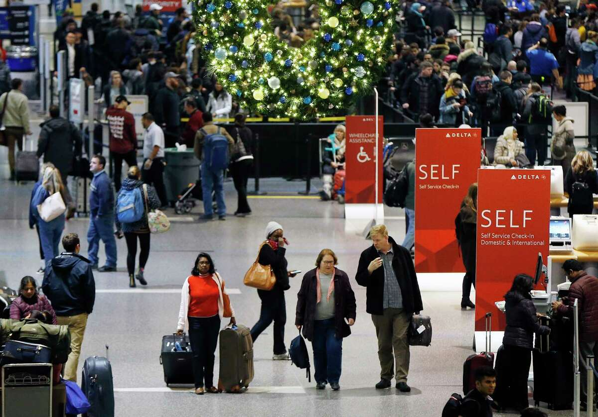 FILE - In this Wednesday, Nov. 22, 2017, file photo, passengers pass through Terminal A at Logan International Airport in Boston. It?'s getting late for booking holiday travel, but not too late. Experts say there are tips for procrastinators to find affordable airfares and hotel rooms. Flexibility is the key. (AP Photo/Michael Dwyer, File) ORG XMIT: NYBZ411