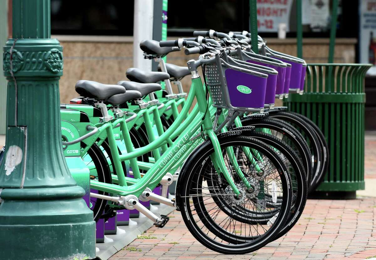 Bicycles available for rent through the CDPHP Cycle! bike share program operated by CDTA are parked at the State and Jay Street stand across from Proctors on Friday, Aug. 25, 2017, in Schenectady, N.Y. (Will Waldron/Times Union)