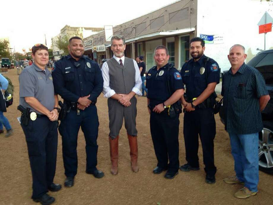 "City of Gonzales Police Department: ""We had some fun yesterday on the wild west streets of Gonzales, TX with Pierce Brosnan who graciously struck a pose with the Gonzales PD while in town filming ""The Son."" Not our ordinary beat."" Photo: Facebook/Gonzales PD"