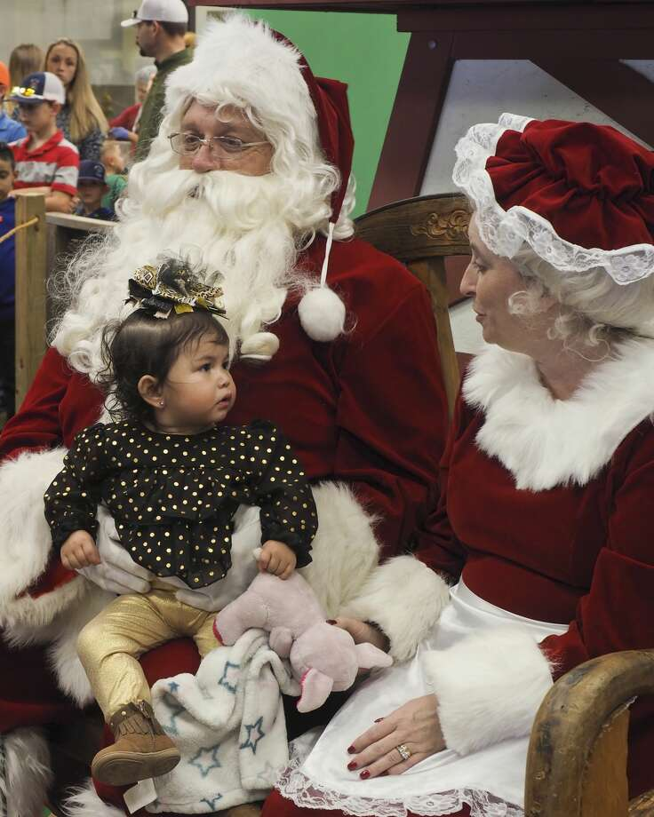 Zaelynn Figeroa sits with Santa and Mrs. Claus who made an appearance 12/02/17 at Susie's South Forty, taking pictures with children and listening to their Christmas wish list. Tim Fischer/Reporter-Telegram Photo: Tim Fischer/Midland Reporter-Telegram