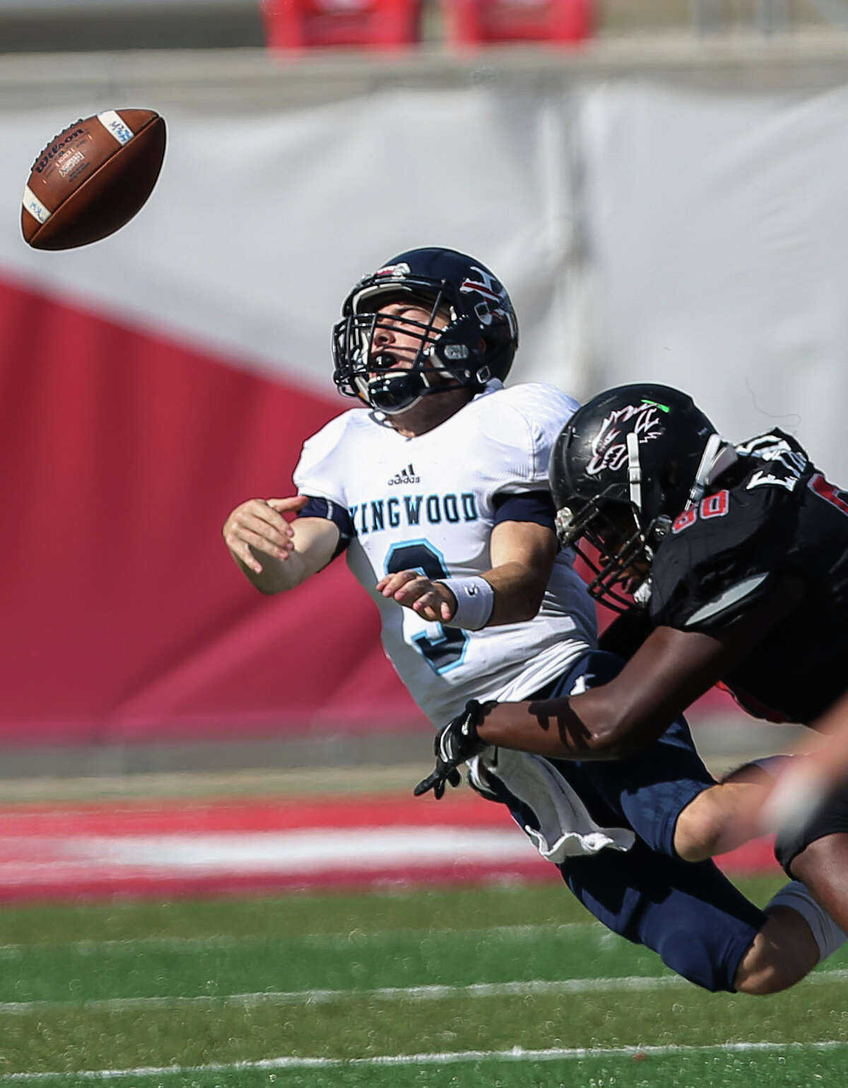 Kingwood quarterback Matt Slayton, left, is sacked by Langham Creek's Ernest Thomas during the first quarter of the Class 6A Division 2 Region 3 playoffs game at TDECU Stadium on Saturday, Dec. 2, 2017, in Houston.