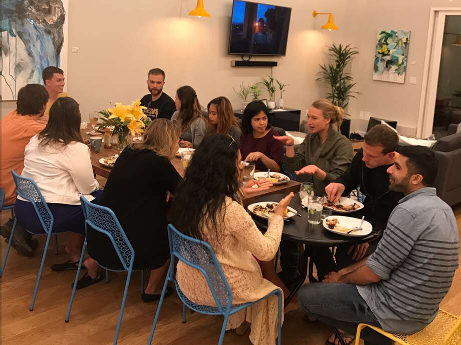 Residents of Mission Starcity eat dinner together. A new startup called Starcity is converting old SF hotels into spaces for communal living. Photo: Starcity