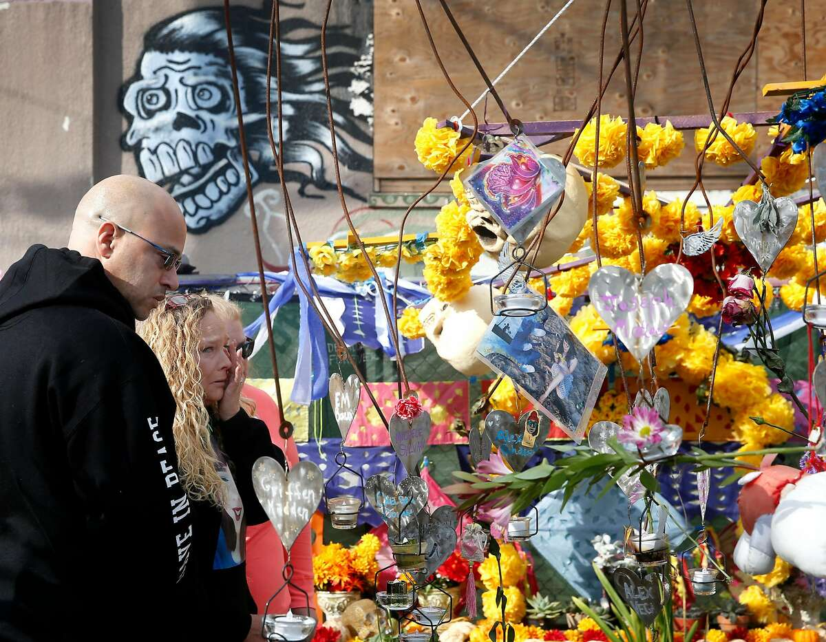 David and Kim Gregory attend a memorial service in front of the Ghost Ship warehouse in Oakland, Calif. on Saturday, Dec. 2, 2017 for the 36 people that died in the fire, including their daughter Michela, at the site one year ago.
