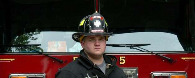 "Chris Rusinik, 21, Ansonia volunteer firefighter at Hilltop Hose Company No. 5: America means ""bravery, first off ... and definitely the freedom of keeping everybody safe as much as we can, try and prevent a fire and loss of homes and lives and try to save and help peoples as much as we can."""