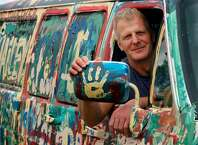 "Trumbull resident Michael Kali, 53, owner of Kali's Auto Body & Auto Sales in Bridgeport, poses in the Grafitti Van painted at a recent fundraiser, Brentapalooza:  ""What makes America great is when people take a moment to lend a helping hand. You can only keep what you have by giving it away. I've been very fortunate, now it's about giving back."""