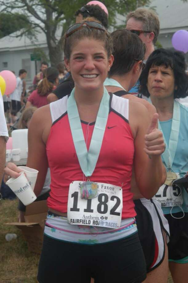 Norwalk's Lauren Madaffari was all smiles after completing the Fairfield Half Marathon on Sunday. Photo: Andy Hutchison, Contributed Photo / Norwalk Citizen
