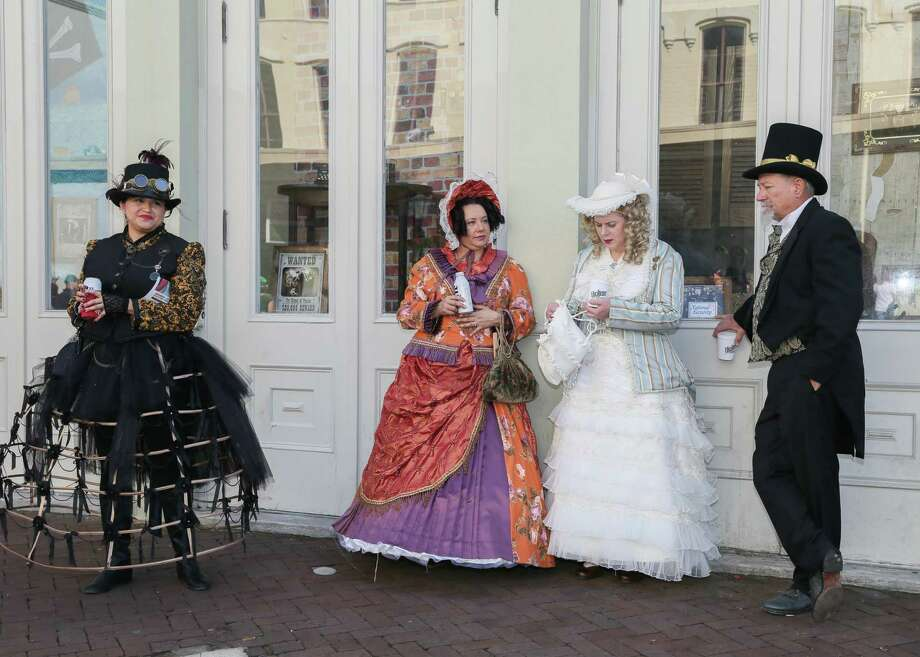 December 2, 2017:  Costumed visitors enjoy the day's activities at the Dickens on the Strand festival in Galveston, Texas. (Leslie Plaza Johnson/Freelance Photo: Leslie Plaza Johnson, For The Chronicle / Freelance