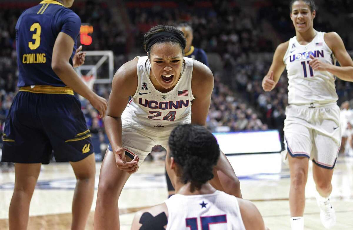 UConn's Napheesa Collier (24) reacts to a made basket by teammate Gabby Williams, bottom, against California.