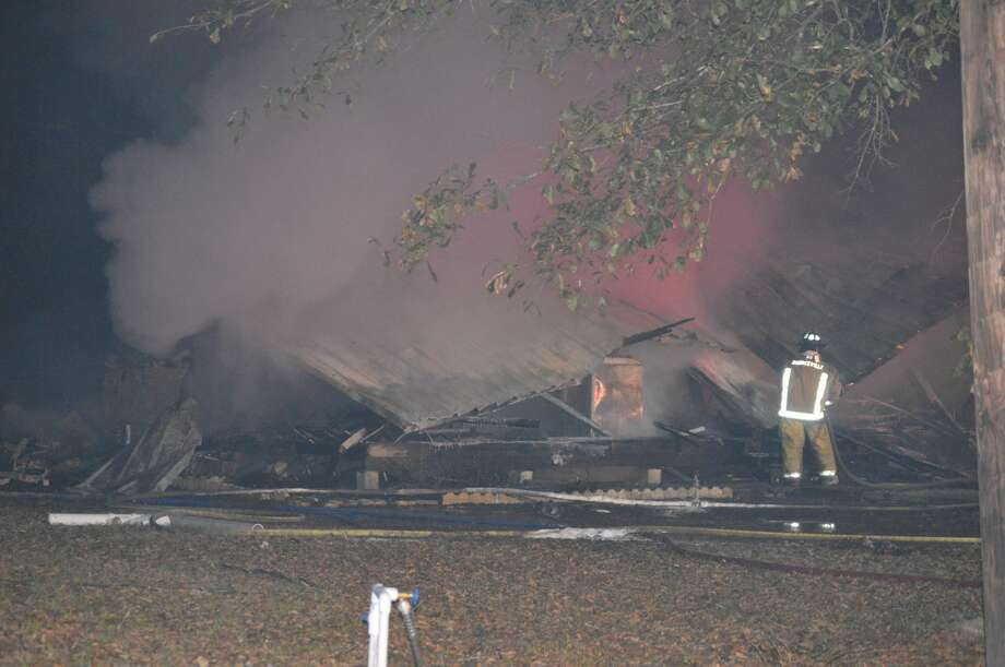 A home in Mauriceville was determined a total loss after a fire destroyed it Friday night. Photo: Eric Williams