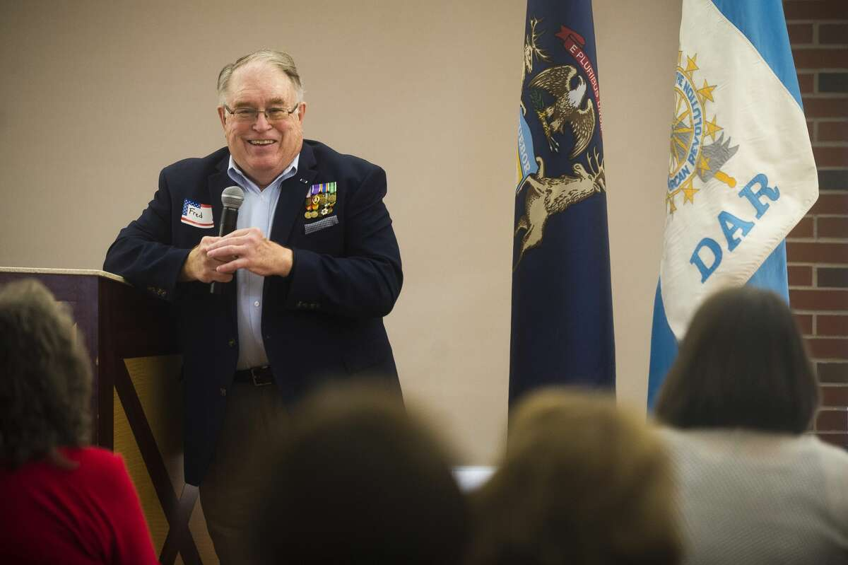 Fred Honerkamp speaks about his service in the Vietnam War during an event commemorating Vietnam veterans on Friday at the Greater Midland Community Center. (Katy Kildee/kkildee@mdn.net)