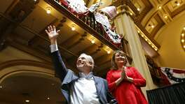 Gov. Greg Abbott, shown with his wife, Cecilia, at Sunset Station at his re-election announcement in July, plans to put about 100 paid field staffers on the ground statewide by mid-January.
