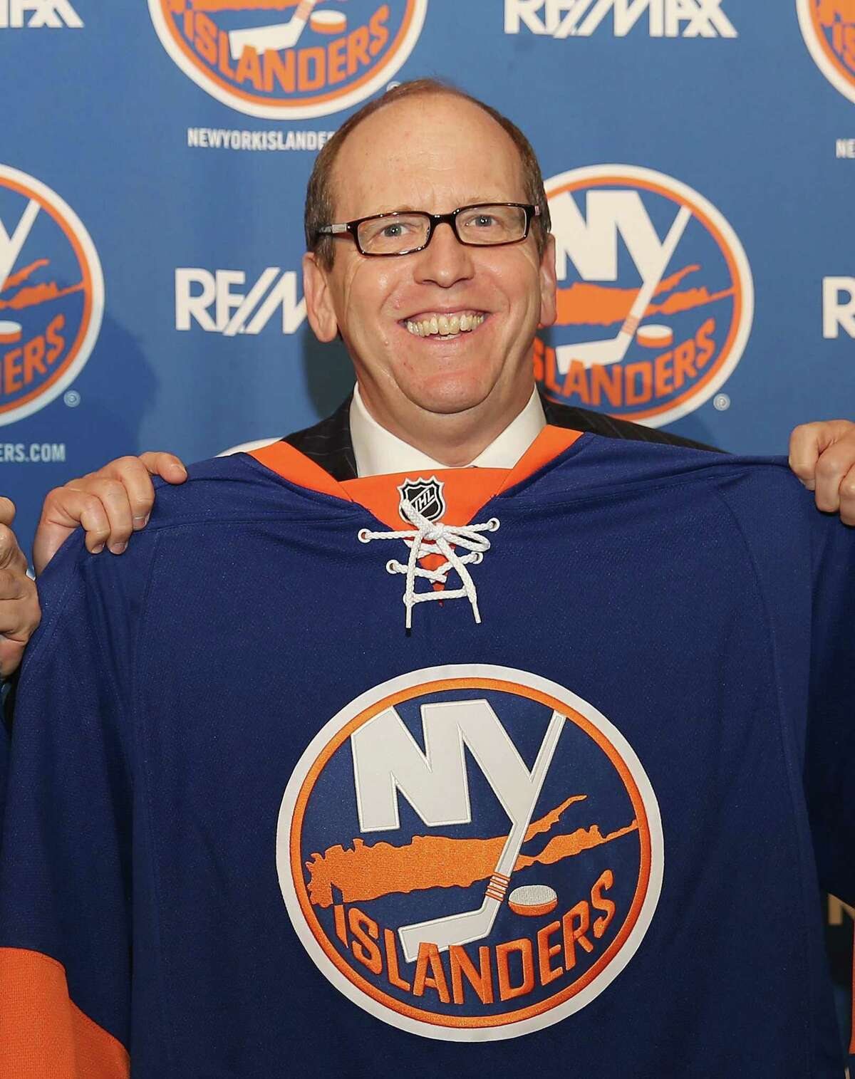 New York Islanders partner Jon Ledecky poses for a photo during a press conference at Nassau Coliseum on Oct. 22, 2014 in Uniondale, N.Y.