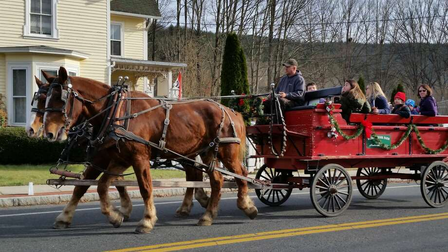 The 27th annual three-day Christmas in Riverton event, included a youth church-group puppet shop, horse-and-buggy rides along Riverton Road, a wine tour, an ice-carving demo in the center of town, and a decorated-tree raffle at the Riverton Grange. Photo: Noel Ambery