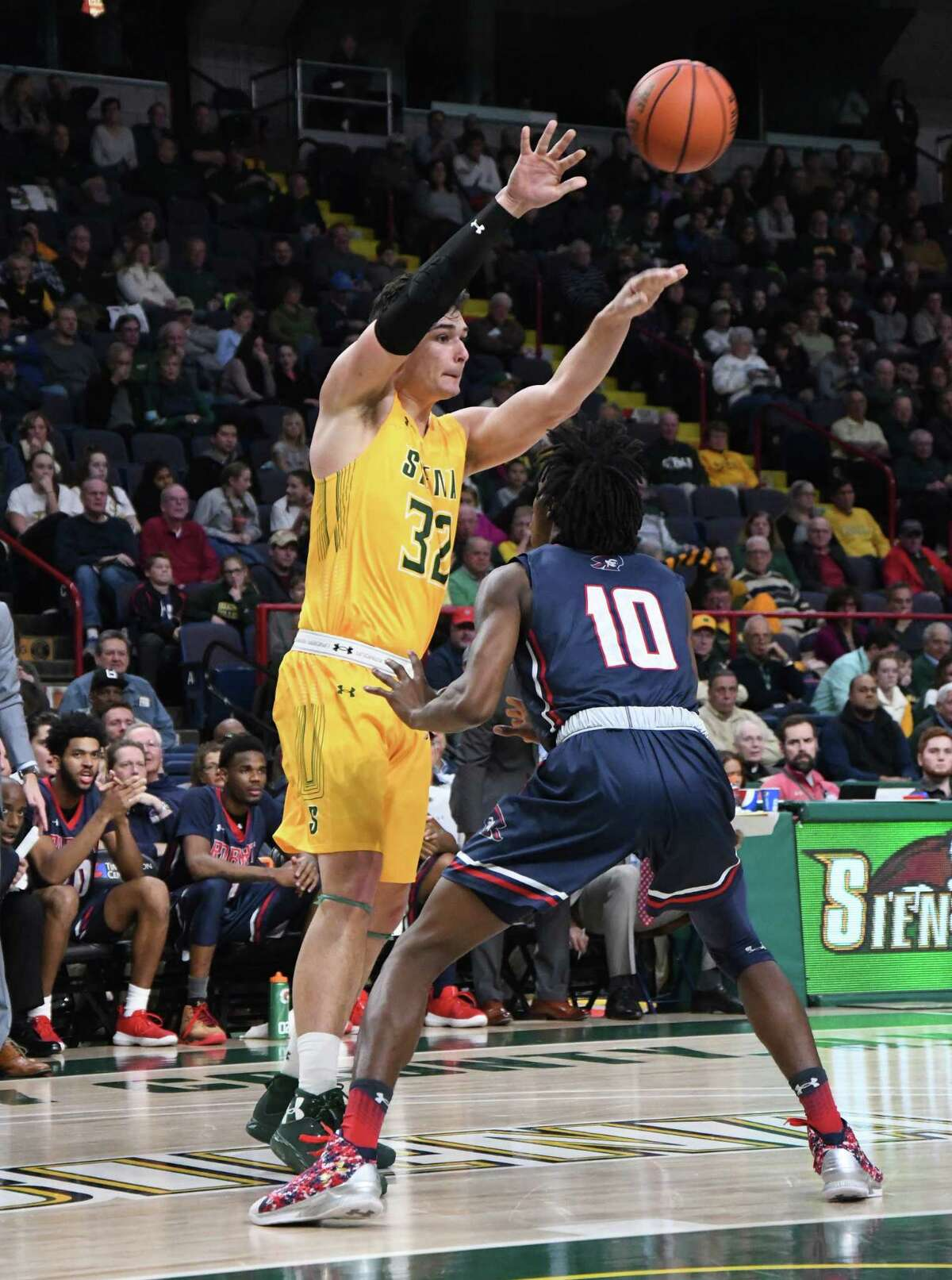 Siena forward Evan Fisher passes the ball to a teammate during a non-conference game against Robert Morris on Saturday at the Times Union Center in Albany. Siena beat Robert Morris 76-74. (Jenn March/Special to the Times Union)