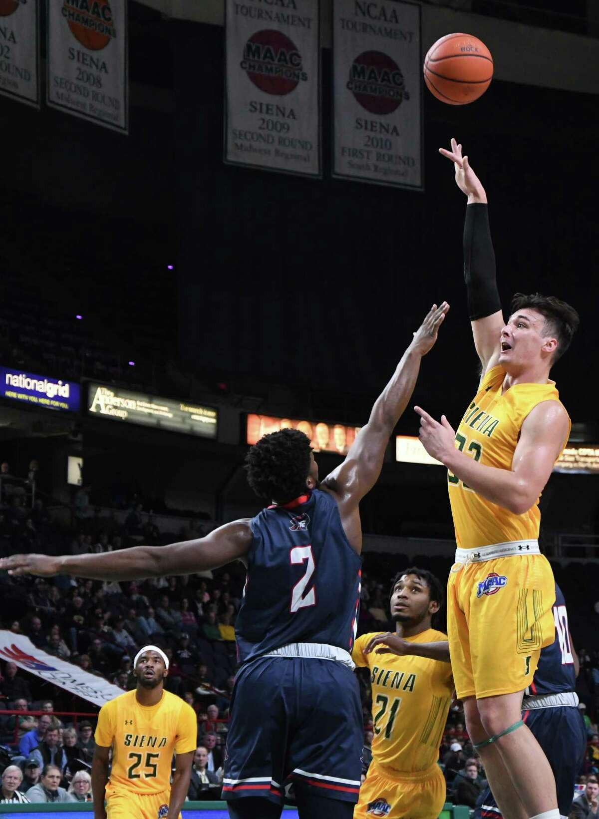 Siena forward Evan Fisher makes a shot during a non-conference game against Robert Morris on Saturday at the Times Union Center in Albany. Siena beat Robert Morris 76-74. (Jenn March/Special to the Times Union)