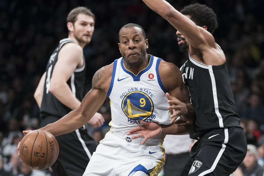 Golden State Warriors forward Andre Iguodala (9) handles the ball against s Brooklyn Nets guard Spencer Dinwiddie during the first half of an NBA basketball game, Sunday, Nov. 19, 2017, in New York. (AP Photo/Mary Altaffer) Photo: Mary Altaffer, Associated Press