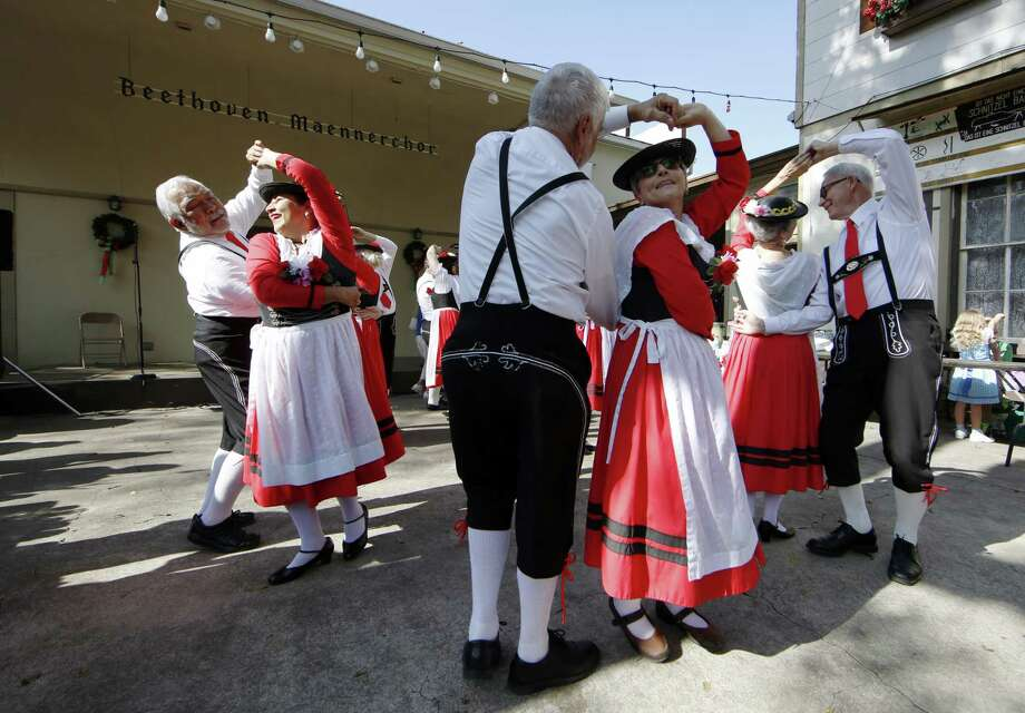 Dancers smile at each other as they perform traditional German folk dancing. Visitors enjoyed the German Christmas culture at the 26th Kristkindlmarkt Saturday, Dec. 02, 2017, at Beethoven Maennerchor in San Antonio. The Beethoven was founded in Feb. 1867 and still looks to preserve German music, language and culture in the Historic King William District on the south side of Downtown San Antonio. R. Tomas Gonzalez Photo: R. Tomas Gonzalez / R. Tomas Gonzalez / R. Tomas Gonzalez