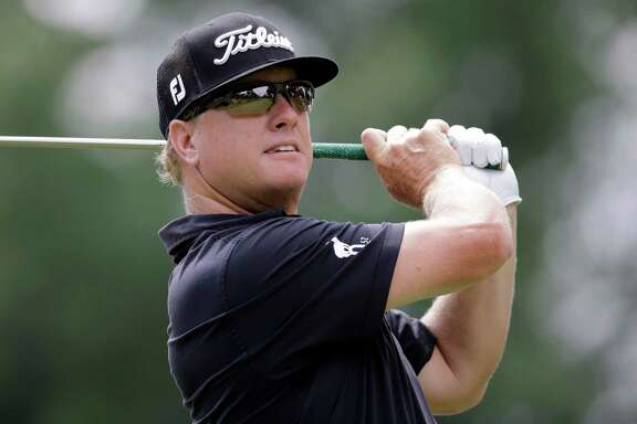 FILE - In this Aug. 6, 2017 file photo, Charley Hoffman tees off on the third hole during the final round of the Bridgestone Invitational golf tournament at Firestone Country Club, in Akron, Ohio. Charley Hoffman is closing in on making the Presidents Cup team for the first time. He has reached as high as No. 20 in the world, the best of his career. He is headed back to the Tour Championship. (AP Photo/Tony Dejak, File)