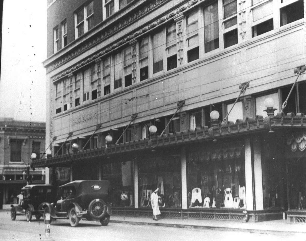 """The Rand Building, shown here at what is now 100 E. Houston St., was built by developer Ed Rand on property formerly owned by the Garza family for two centuries. When completed in 1913, the eight-story building billed as a """"skyscraper"""" was leased to the Wolff & Marx department store and was advertised as the largest building in the South """"devoted exclusively to the retailing of dry goods."""""""
