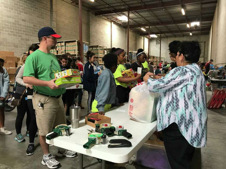 Volunteers with BE A Resource for CPS Kids sort and prepare holiday gifts for children under the care of Child Protective Services in a Heights neighborhood warehouse on Saturday. Photo: Rebecca Elliott / Houston Chronicle