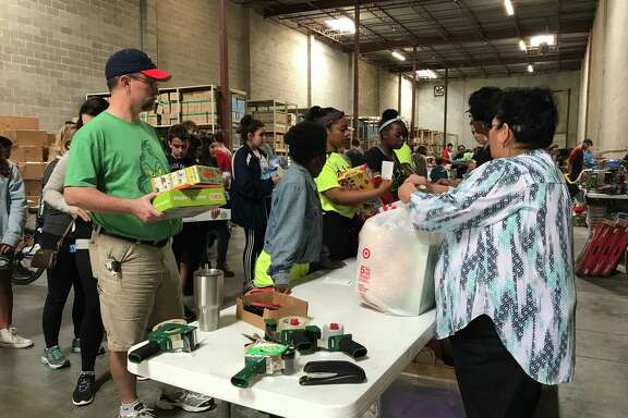 Volunteers with BE A Resource for CPS Kids sort and prepare holiday gifts for children under the care of Child Protective Services in a Heights neighborhood warehouse on Saturday.