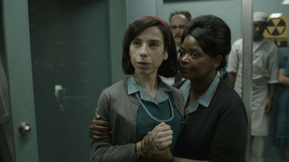 """This image released by Fox Searchlight Pictures shows Sally Hawkins, left, and Octavia Spencer in a scene from the film """"The Shape of Water."""" (Fox Searchlight Pictures via AP)"""