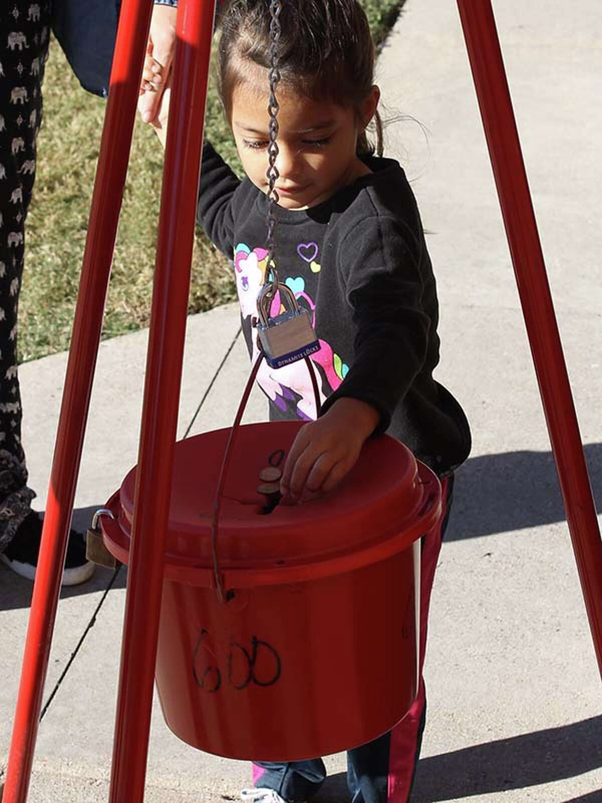 Jubilee Longoria donates to the Salvation Army red kettle.