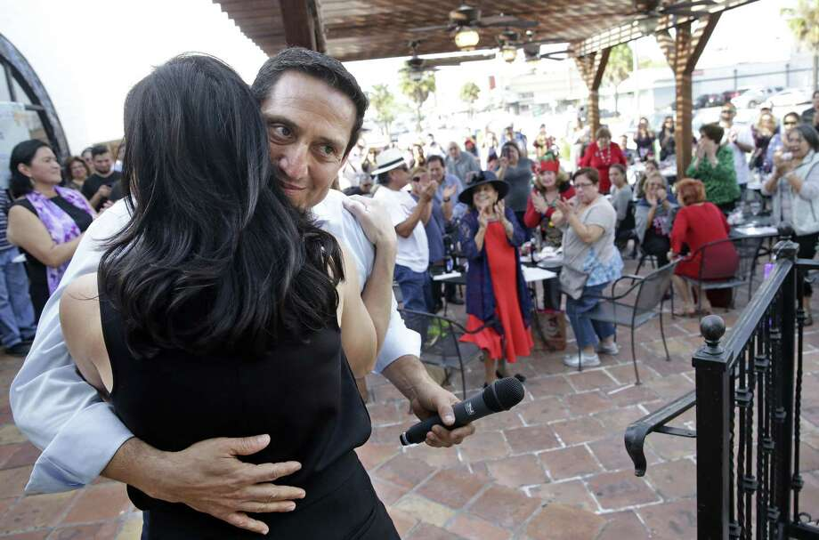 Trey Martinez Fischer gets a hug from his wife Liz after she offered an emotional introduction prior to his announcing his intentions to once again run for state legislative office on December 2, 2017 Photo: Tom Reel, Staff / San Antonio Express-News / 2017 SAN ANTONIO EXPRESS-NEWS