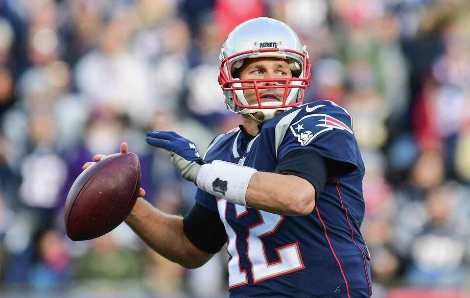 FOXBORO, MA - NOVEMBER 26:  Tom Brady #12 of the New England Patriots throws during the second quarter of a game against the Miami Dolphins at Gillette Stadium on November 26, 2017 in Foxboro, Massachusetts.  (Photo by Adam Glanzman/Getty Images) ORG XMIT: 700070763 Photo: Adam Glanzman / 2017 Getty Images