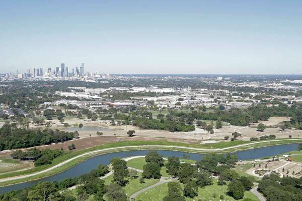 An aerial view of Brays Bayou along the Brays Bayou Greenway Trail and Forest Park Lawndale Cemetery is shown during a Houston Parks Board Bayou Greenways 2020 project tour Monday, Oct. 16, 2017, in Houston. ( Melissa Phillip / Houston Chronicle )