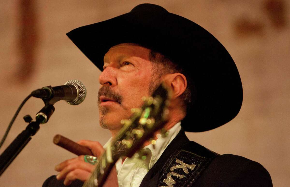 Texas Agriculture Commissioner candidate Kinky Friedman performs with his band Kinky Friedman & the Texas Jewboys at the Historic Sparkle Icehouse Event Hall in Conroe on Saturday.
