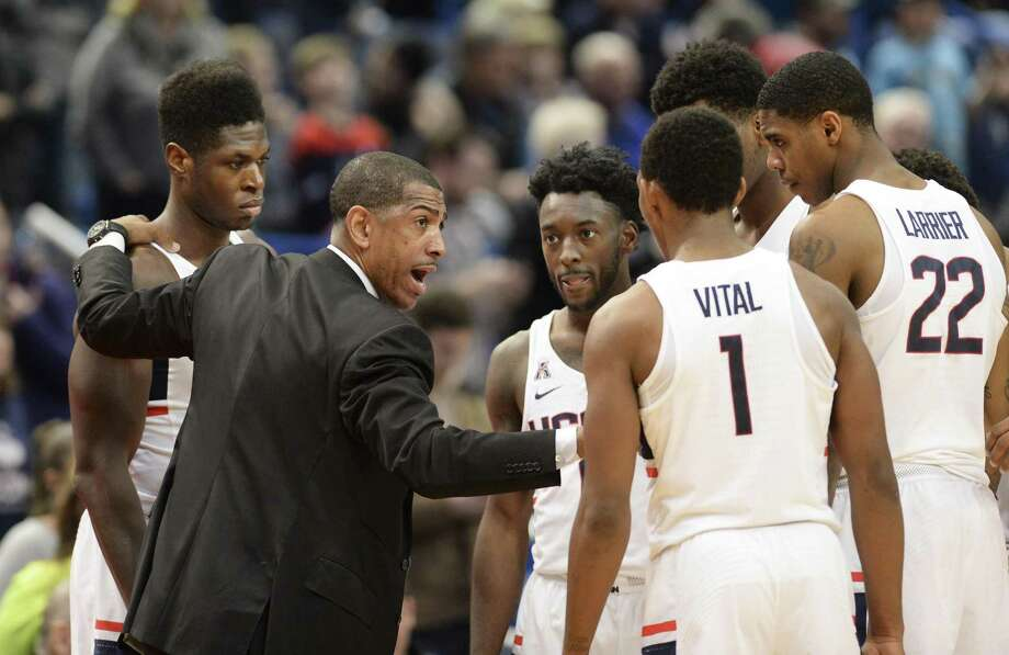 Connecticut head coach Kevin Ollie talks to his team during a timeout in the second half of an NCAA college basketball game Saturday, Dec. 2, 2017, at the XL Center in Hartford, Conn. Connecticut won 84-81. (AP Photo/Stephen Dunn) Photo: Stephen Dunn / Associated Press / FR171426 AP