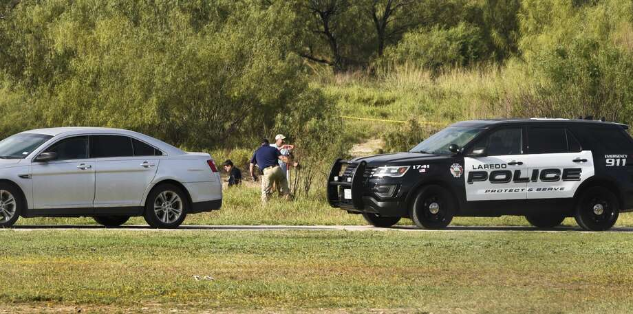 Authorities assess the scene where a deceased person was found at Cheyenne Park. Photo: Danny Zaragoza/Laredo Morning Times